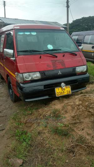 Neat and Strong Mitsubishi L300 2002 Red | Buses & Microbuses for sale in Eastern Region, New-Juaben Municipal
