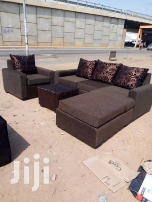 Chocolate Colour L- Shaped Sofa Chair With a Centre Table | Furniture for sale in Greater Accra, Adabraka